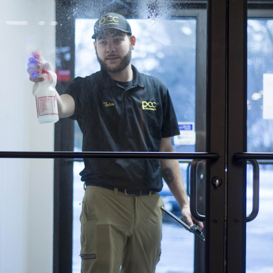 Commercial glass door in Portland ME being cleaned