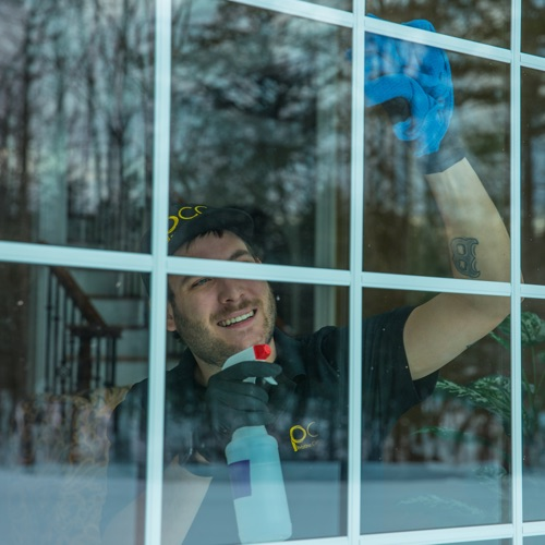 Residential windows being cleaned by window cleaning crew in Portland ME