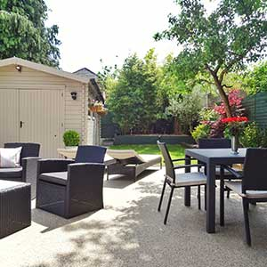 Bournemouth House Sales garden with rattan furniture and shed