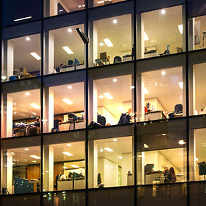 view from outside into windows of a commercial office building at night