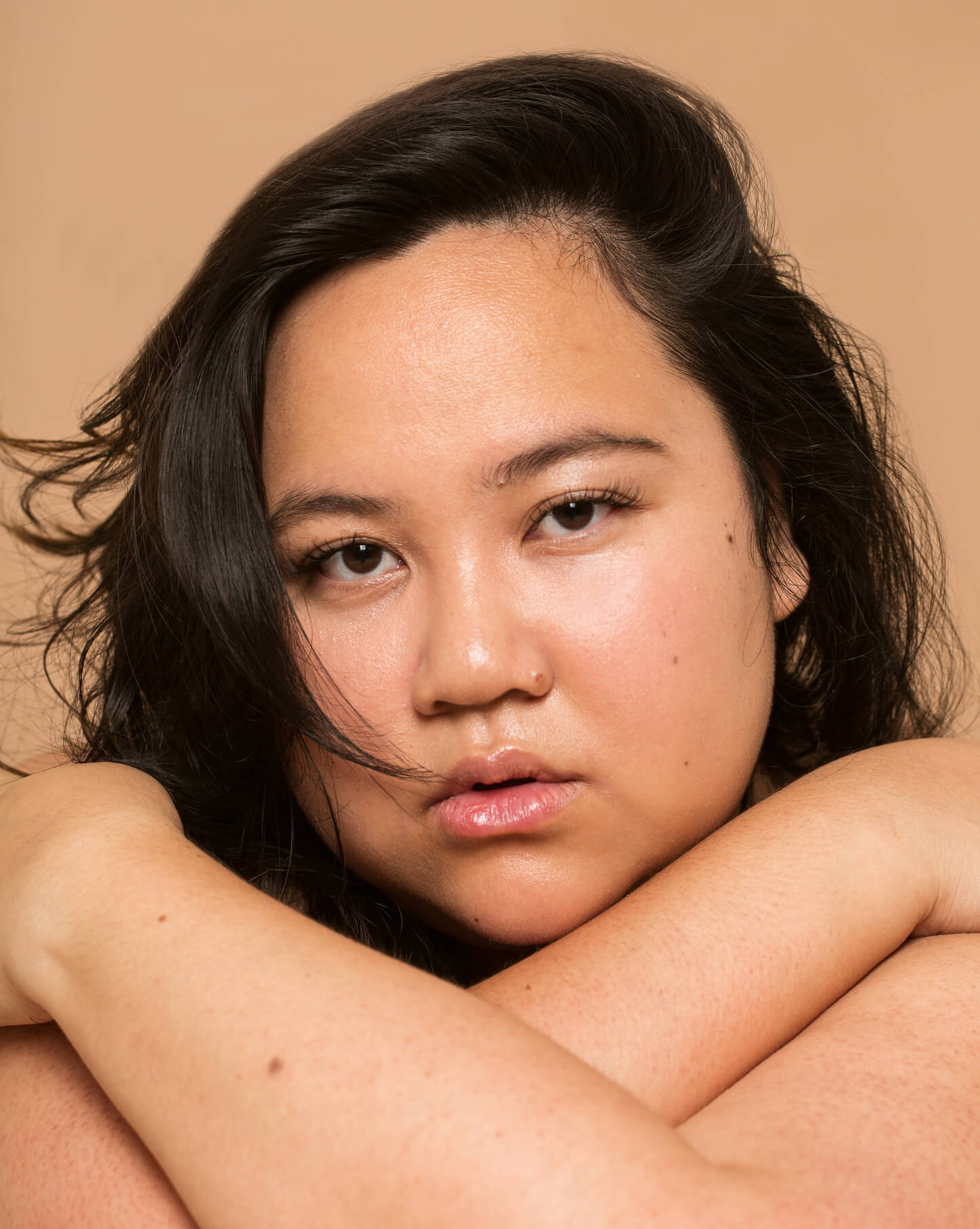 Photo of a woman hugging herself (Phoebe Cheong Photography)