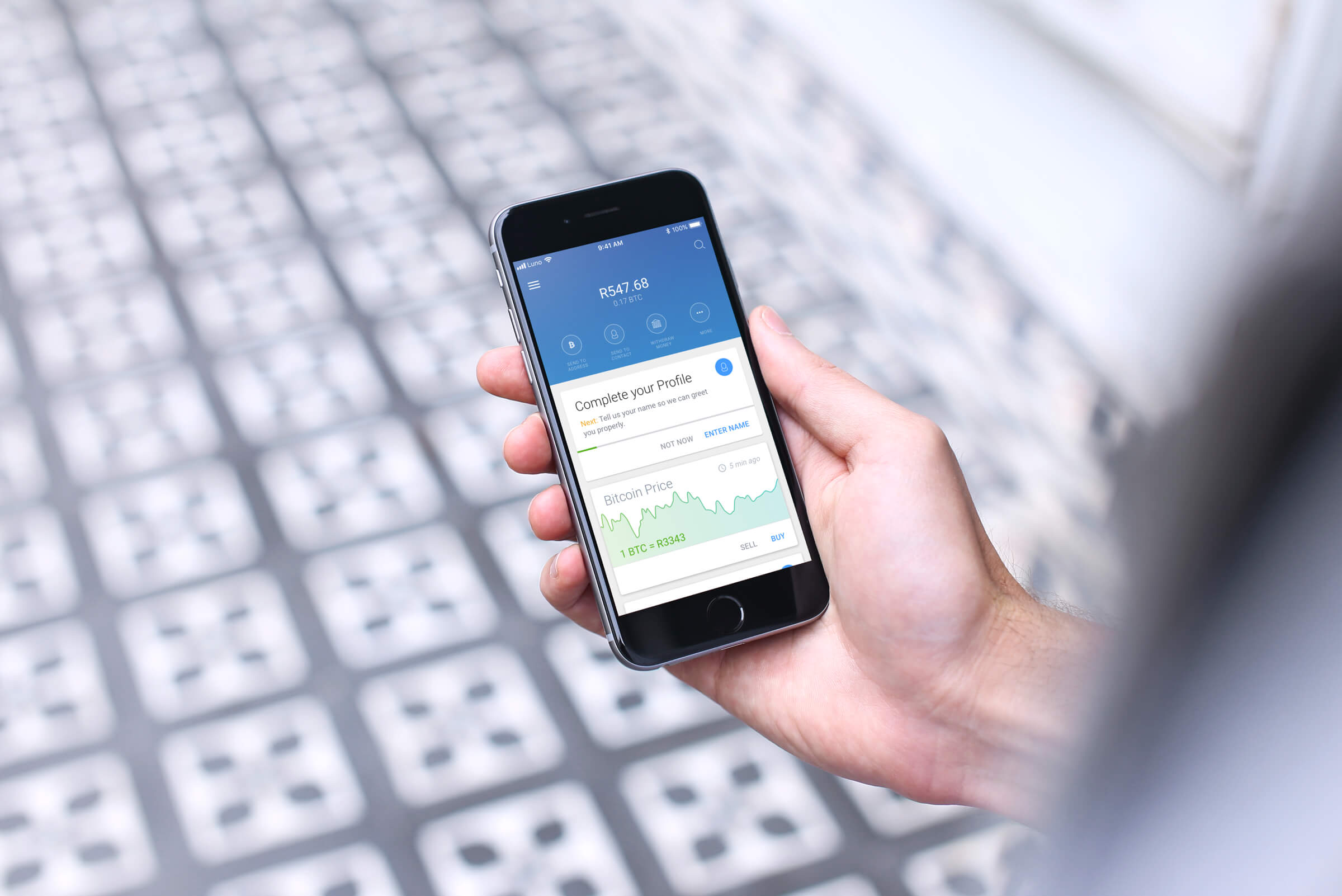 a human holding an iphone displaying the luno iso app
