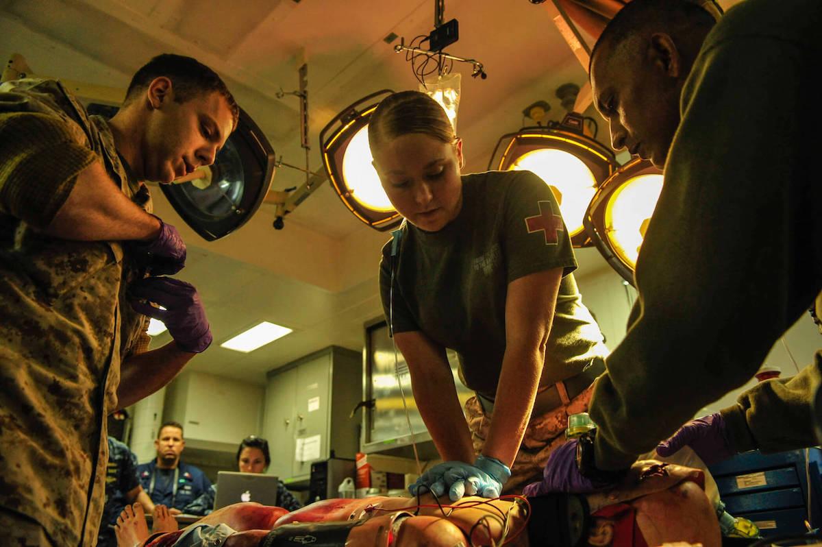 Paramedics learning CPR.