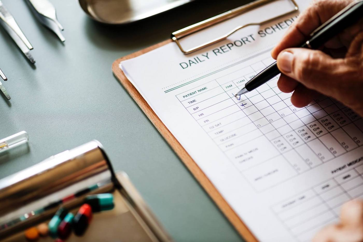 Person completing a medical form on paper