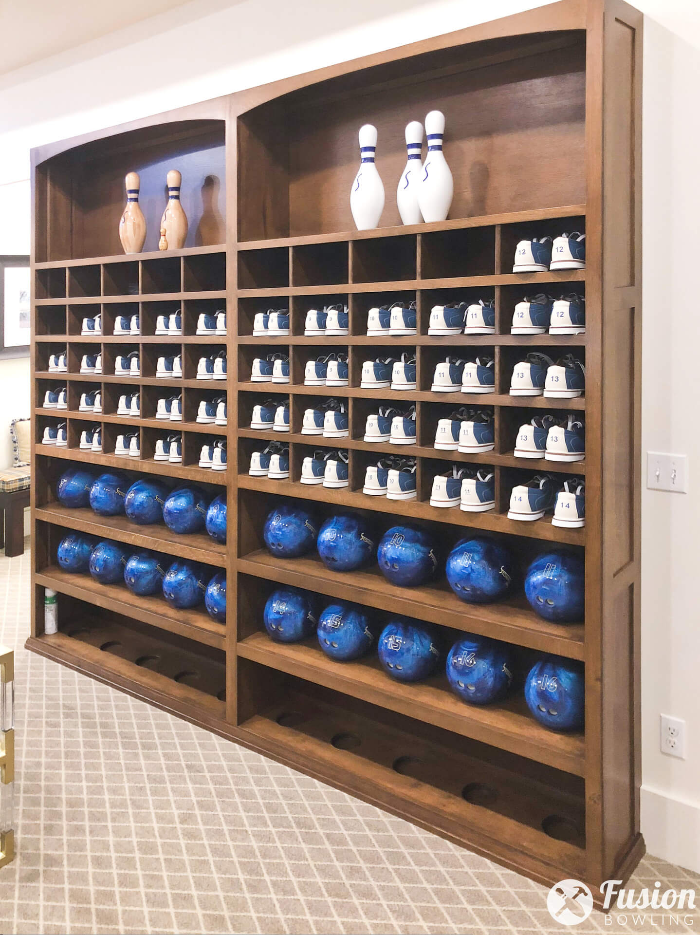 Custom built-in shelving and cubbie holes for bowling balls and bowling shoes.
