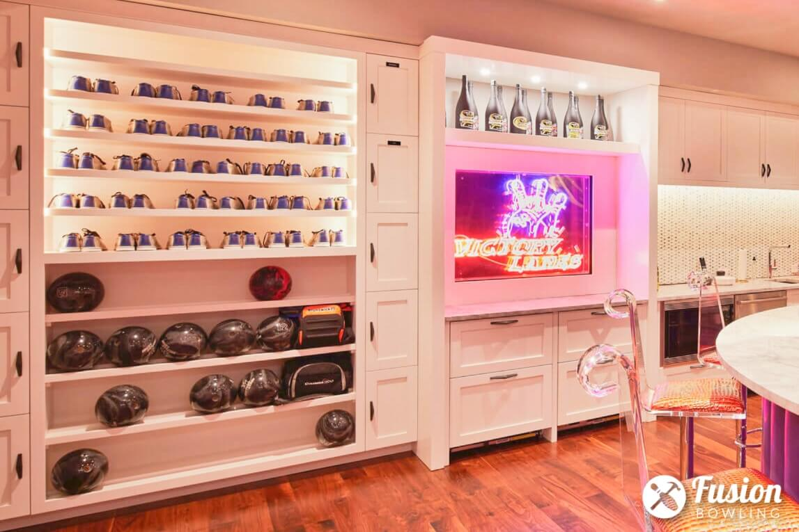 Built-in storage for bowling balls and shoes.