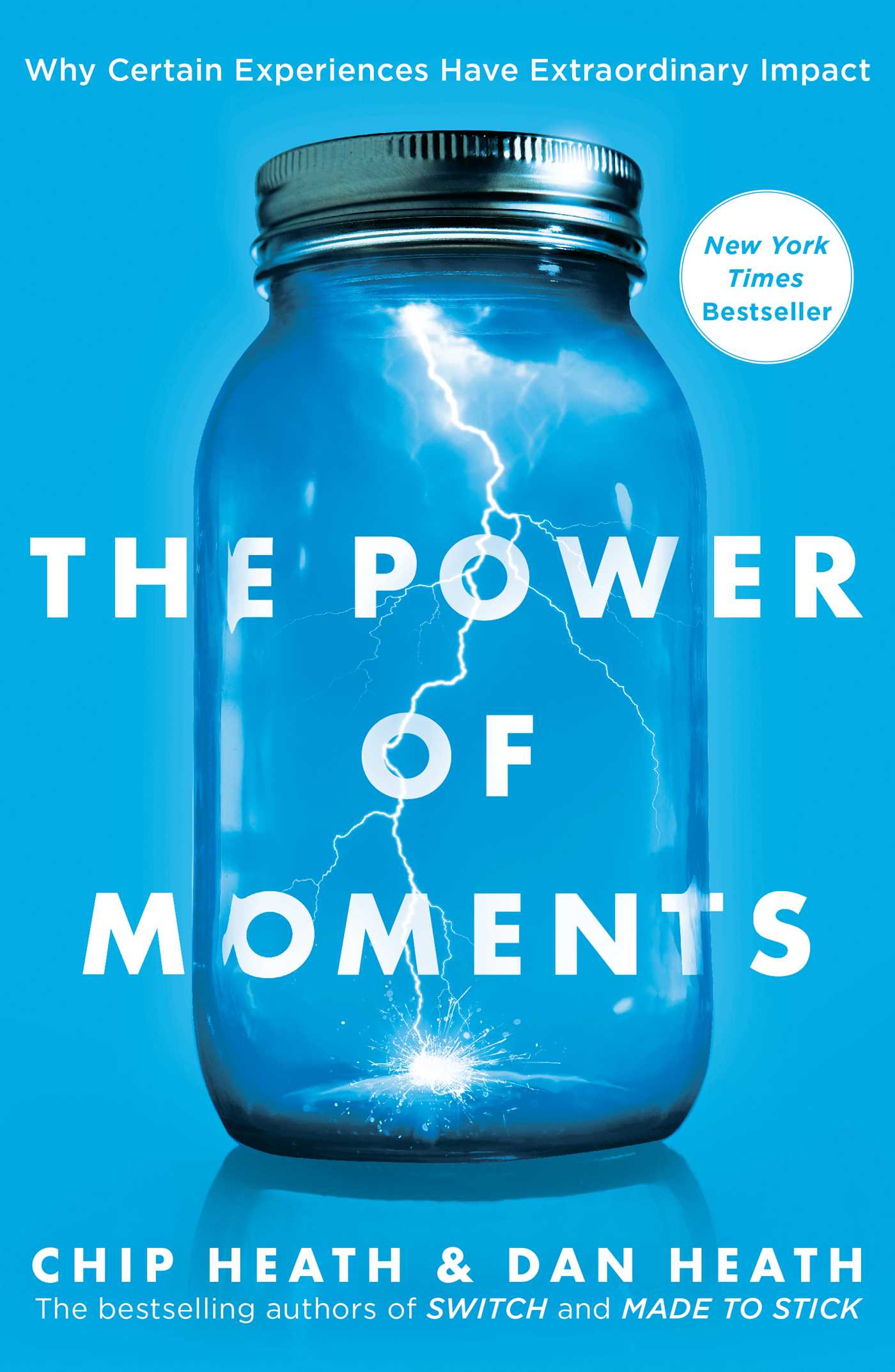 The cover of the book, 'The Power of Moments', showing a lightening strike inside a jar.