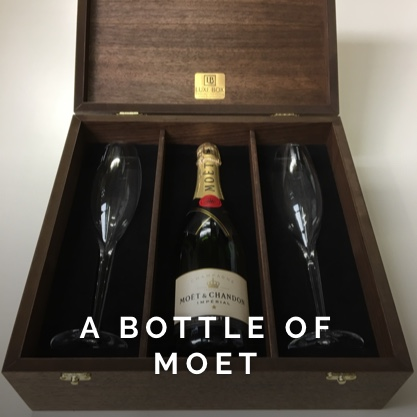 A beautiful box made for a wedding with the world famous Moet champagne presented inside.