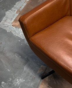 Photo of a couch and floor, showing an example of the industrial style interior in Puzl CowOrKing.