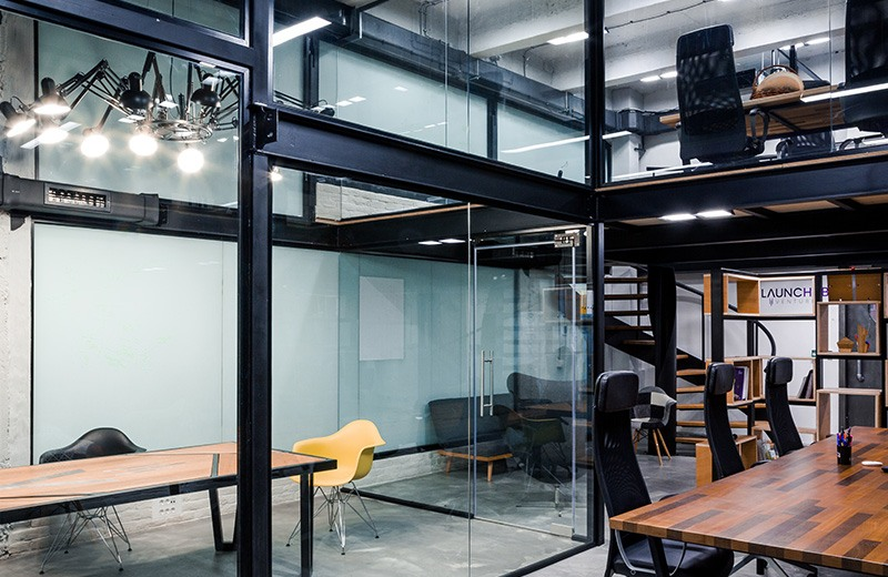 Beautiful custom designed private office on two floors with a meeting room in Puzl CowOrKing.
