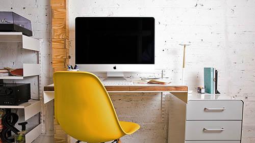 Adjustable Desk and modular shelves in office design