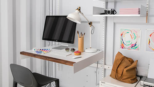 Modular Shelves and Adjustable Desk in container workspace
