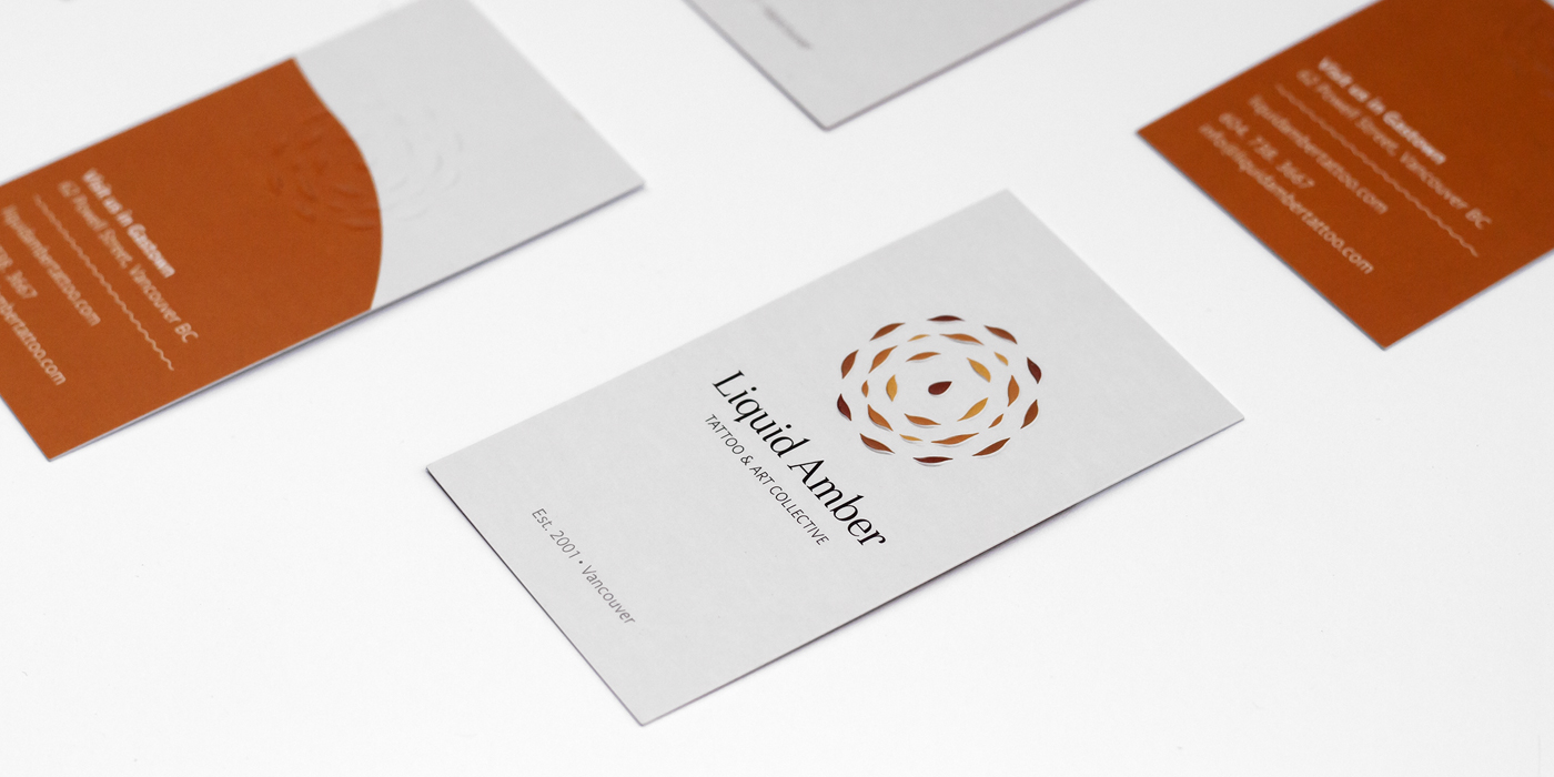 Liquid amber andrew scherle design their logo was embossed into the business cards making it visible on the front and back as well as adding an interesting dimensional element colourmoves