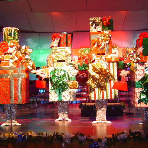 People performing on stage as presents
