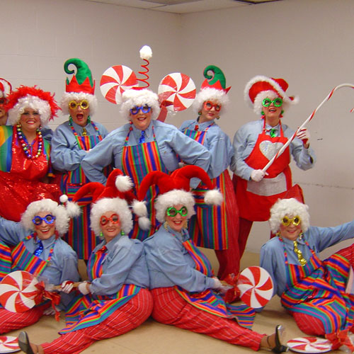 Women posing in festive uniforms