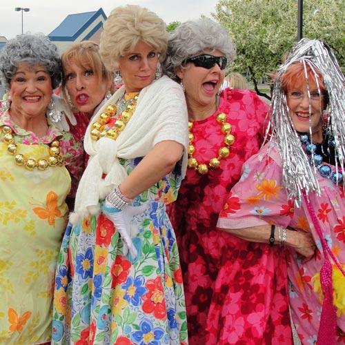 Women dressed as older ladies posing for picture