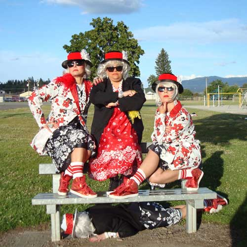 Women posing on a park bench