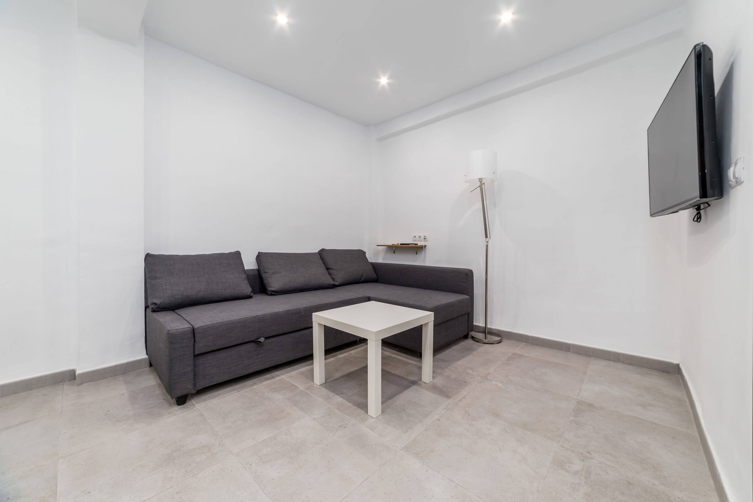 Holaflats Pianista Apartment Living Room with sofa and TV