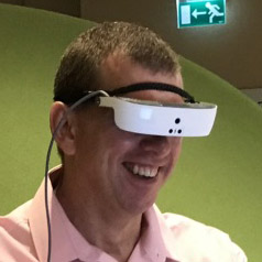 Photo of Alex wearing eSight