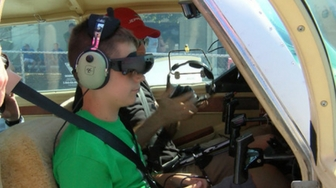 Technology gives legally blind Peoria boy a chance to fly