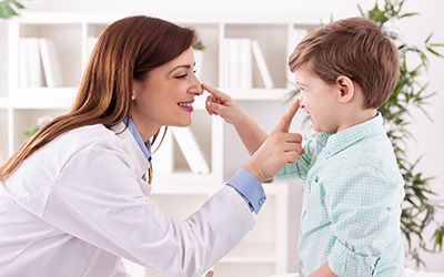 Doctor and pediatric patient in St. Paul, MN