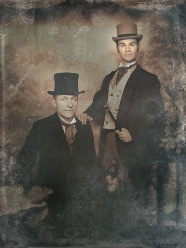 Two men, owners of historic holiday rental,  posing in historic costume.