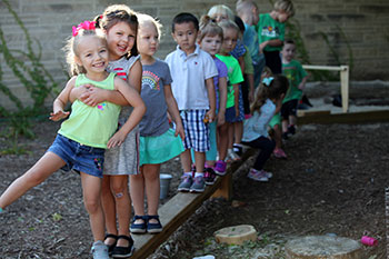 preschool children on a balance beam