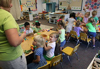 Preschool students in classroom with teacher