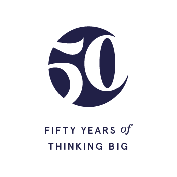 """Standalone navy icon with """"Fifty Years of Thinking Big"""" below."""