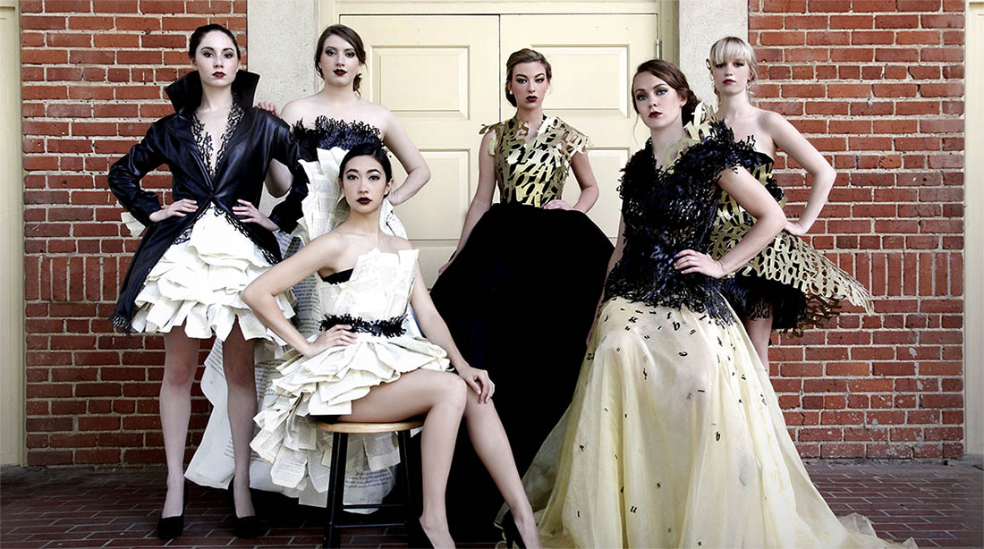 Group photo of six models in fashion line.