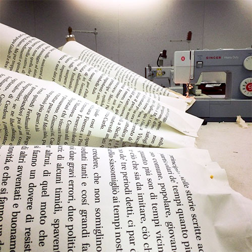 Wallpaper book pages sewn together.