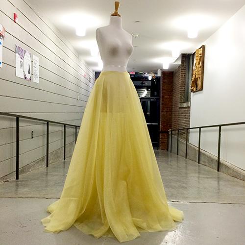 Long golden skirt on a mannequin.