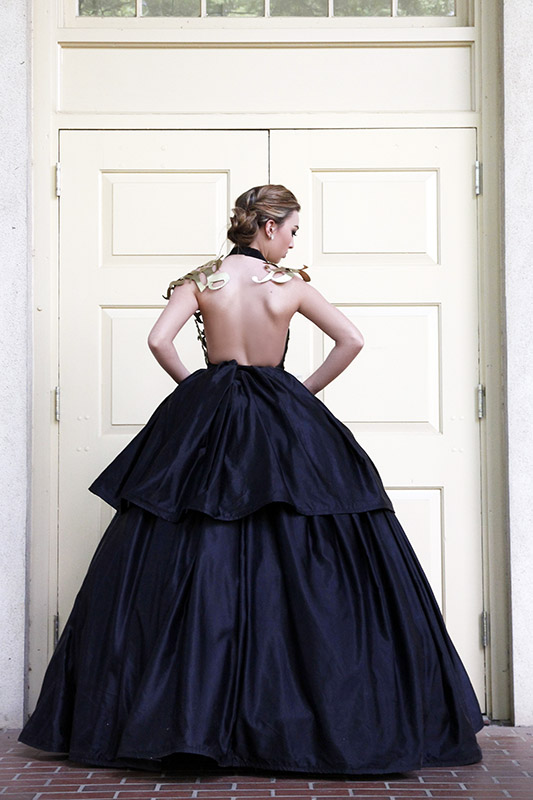 Back of model with metal top and hoop skirt bottom.