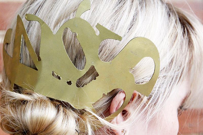 Metal typography in blonde hair.