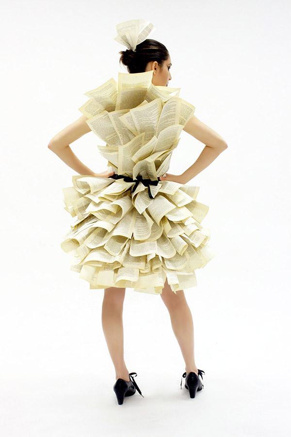 Model showing back of paper dress.