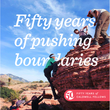 "A man climbing a rock formation with men above and below to help him climb. ""Fifty years of pushing boundaries"" in text overlaid."