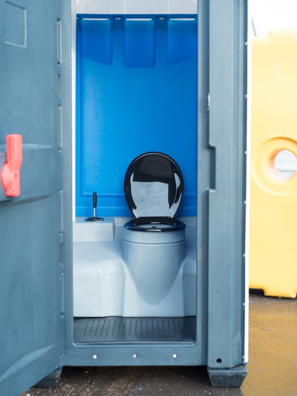 Interior featuring recirculating flush toilet