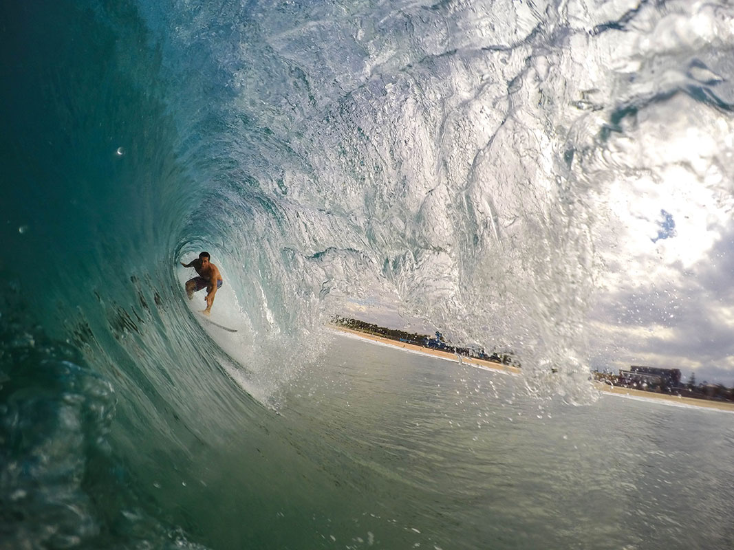 A surfer in a tube