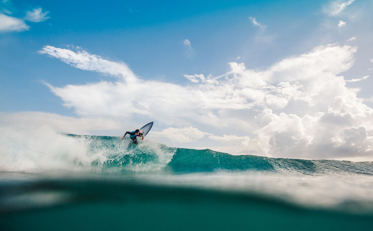 Surfer shredding a wave