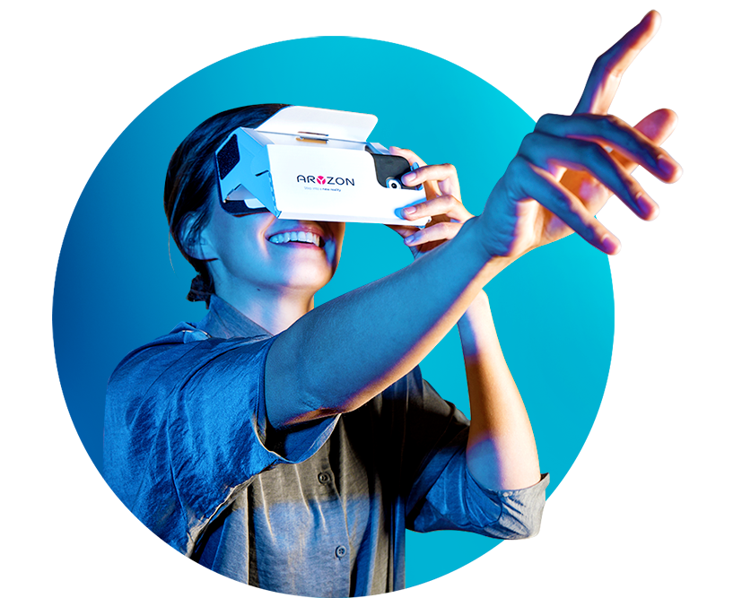 A woman looking through the Aryzon 3D augmented reality headset and pointing at what she is seeing.