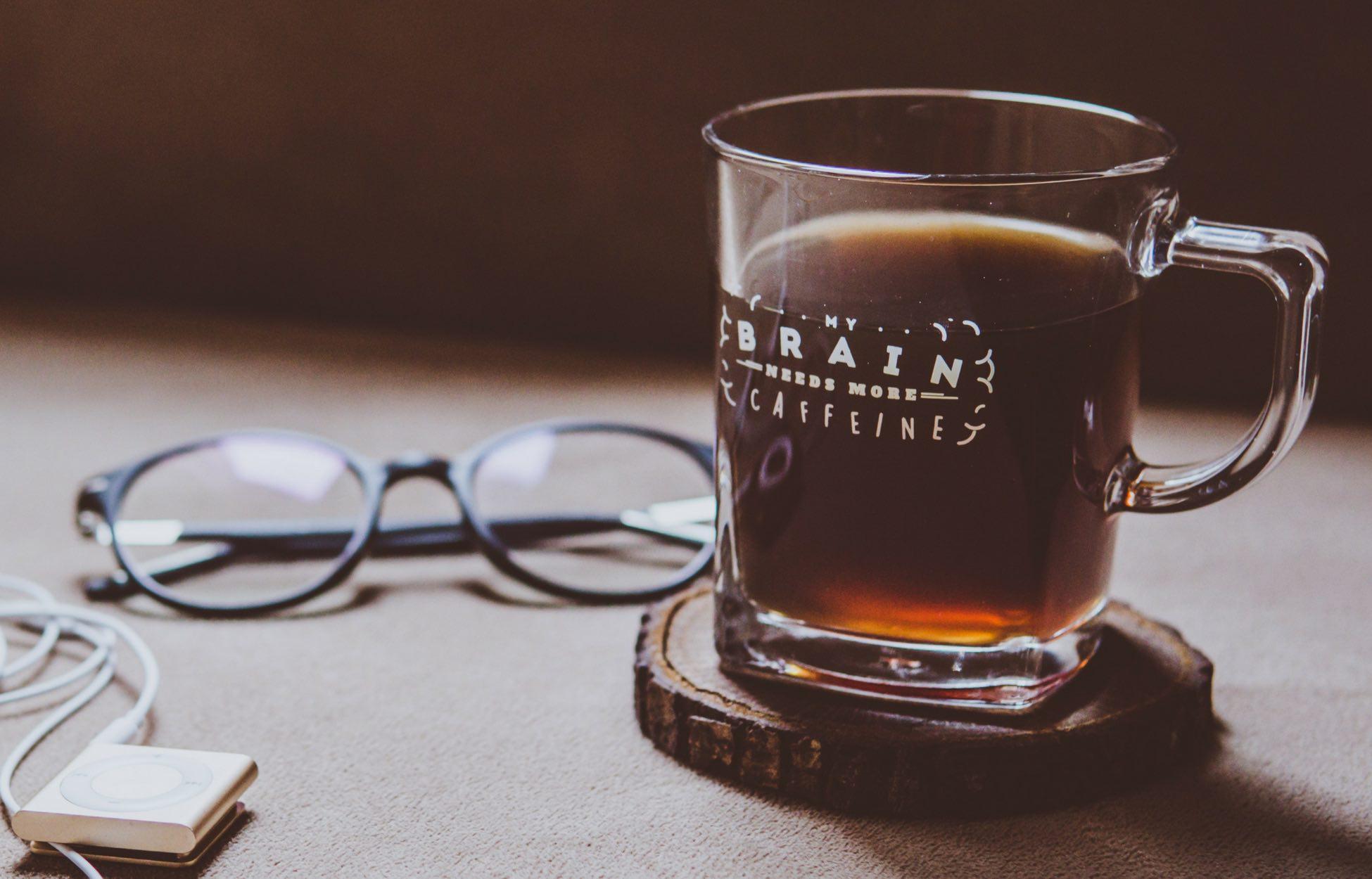 coffee glass with 'brain needs more caffeine' written on