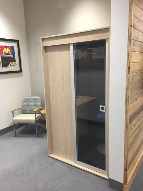 Privacy booth blending in oak