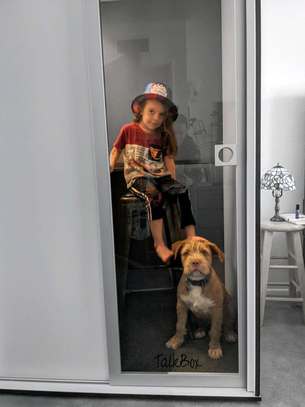 Child and dog in TalkBox booth