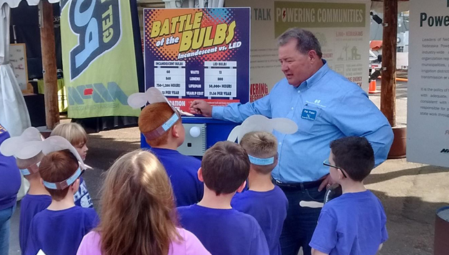 Pat Pope, President and CEO, speaking to students at Nebraska State Fair
