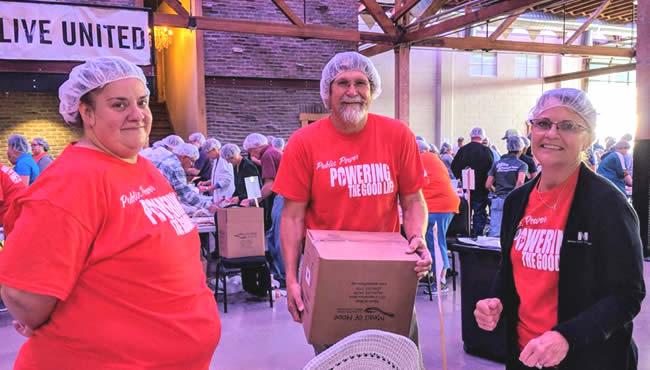 Employees volunteering at food pantry
