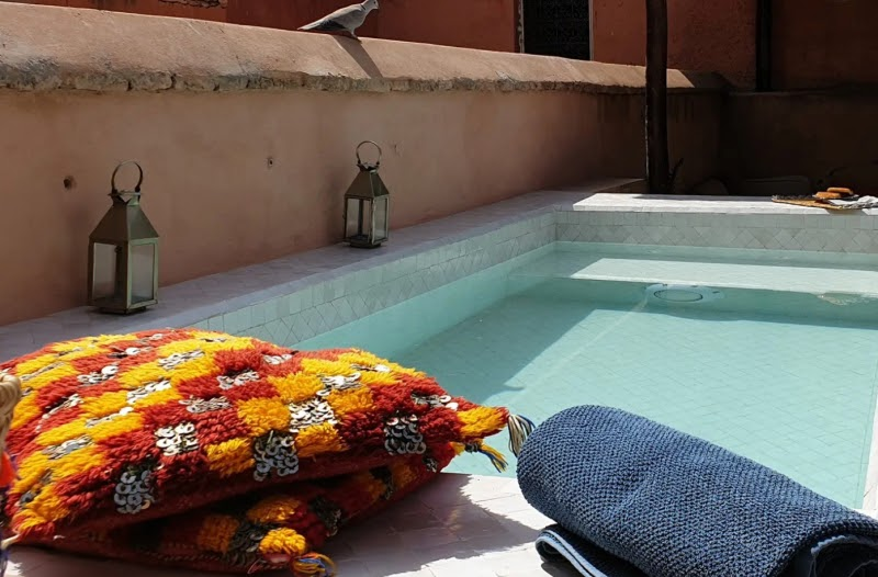 design inspiration color marrakech red orange pillow pool