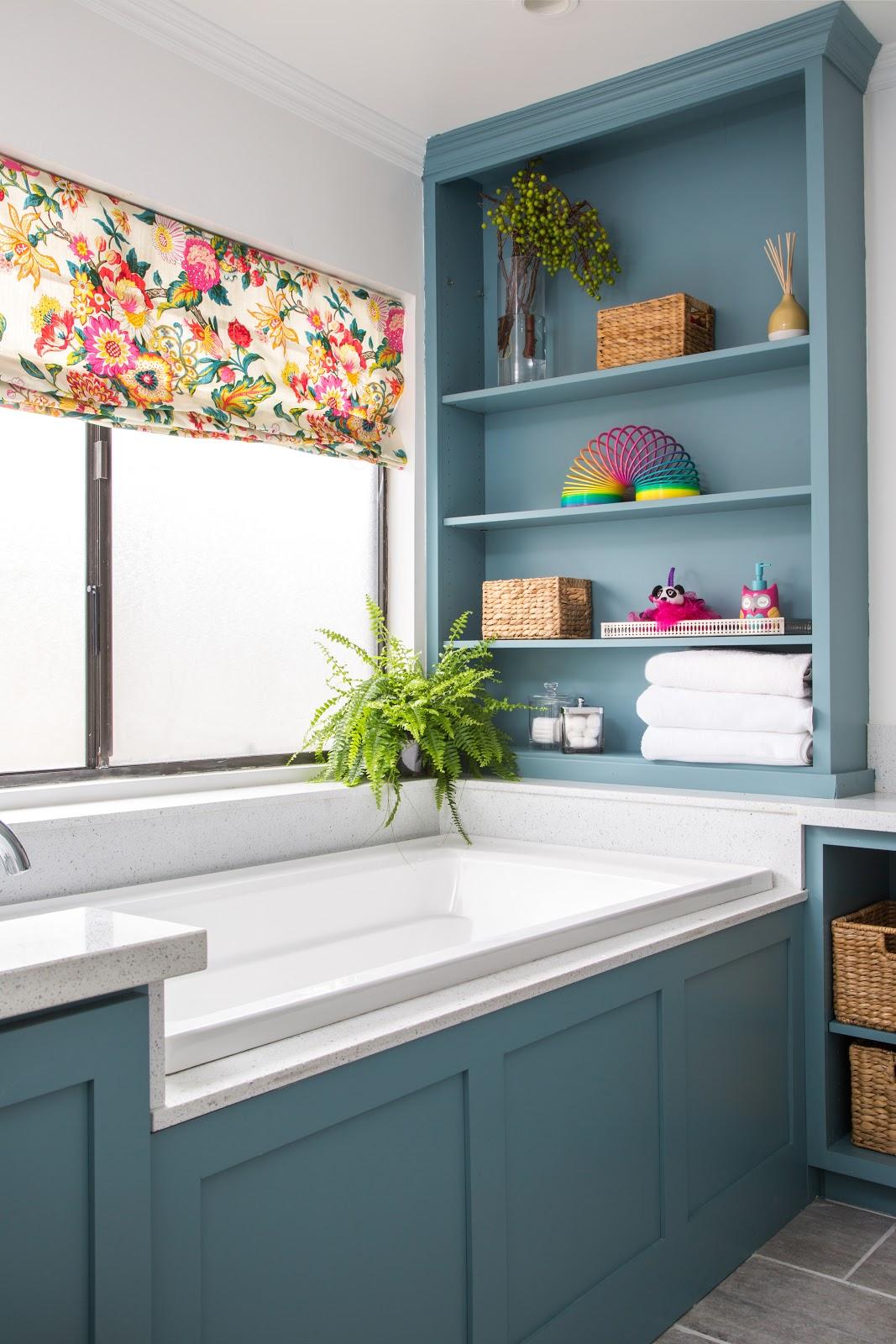 floral roman shades blue builtin shelving bathtub guest bathroom joy street design