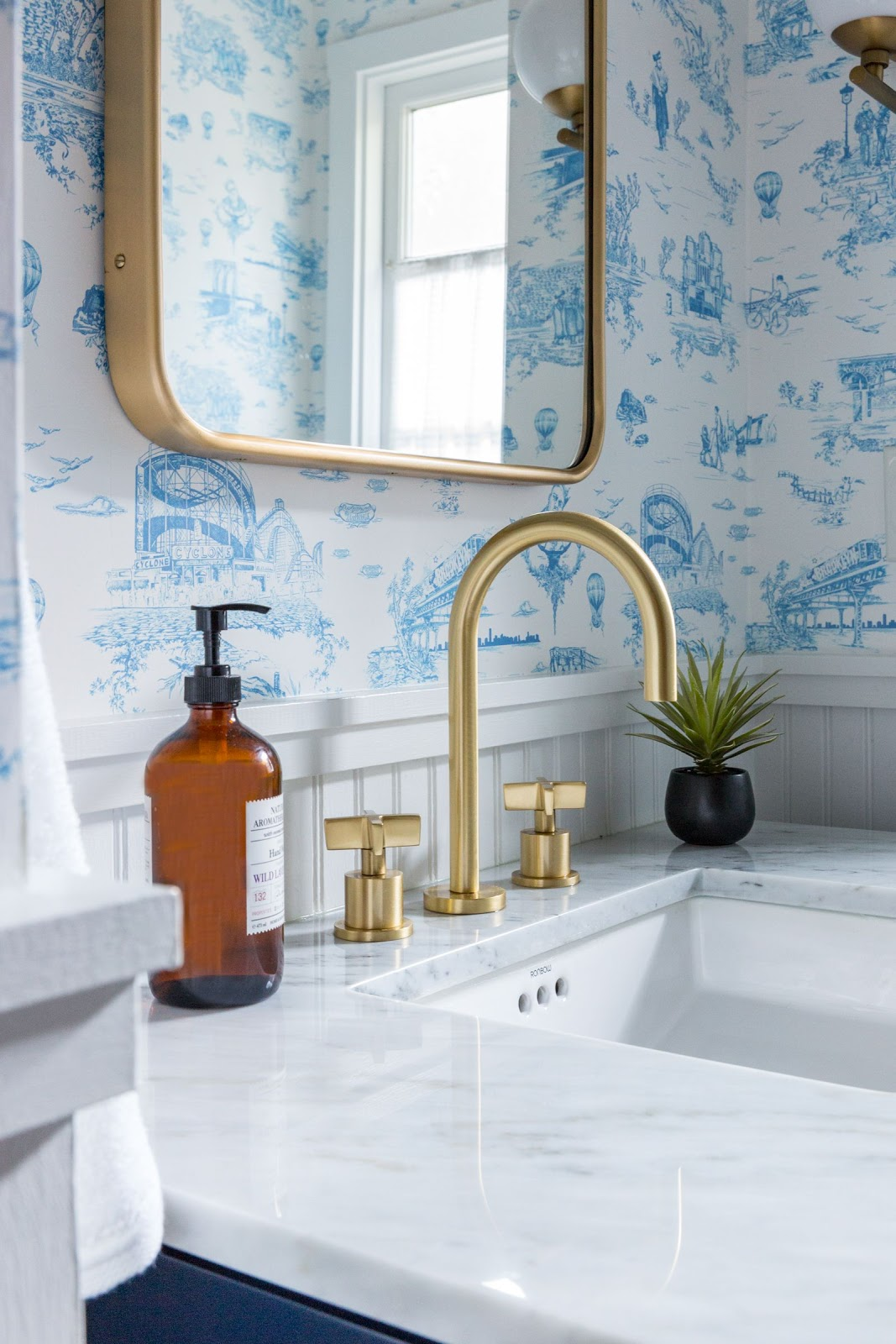powder room fresh bright oaklands hills brass sconce white blue brooklyn wallpaper white wainscoting