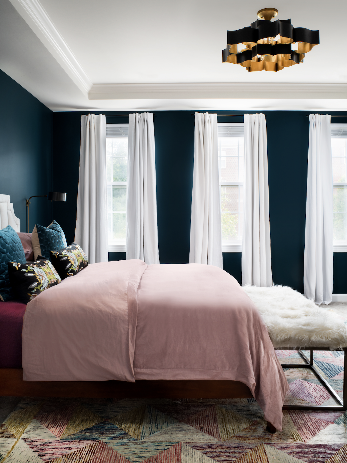 currey and co lighting black gold fixture white curtains blue walls white ceiling moody soothing bedroom loloi rug