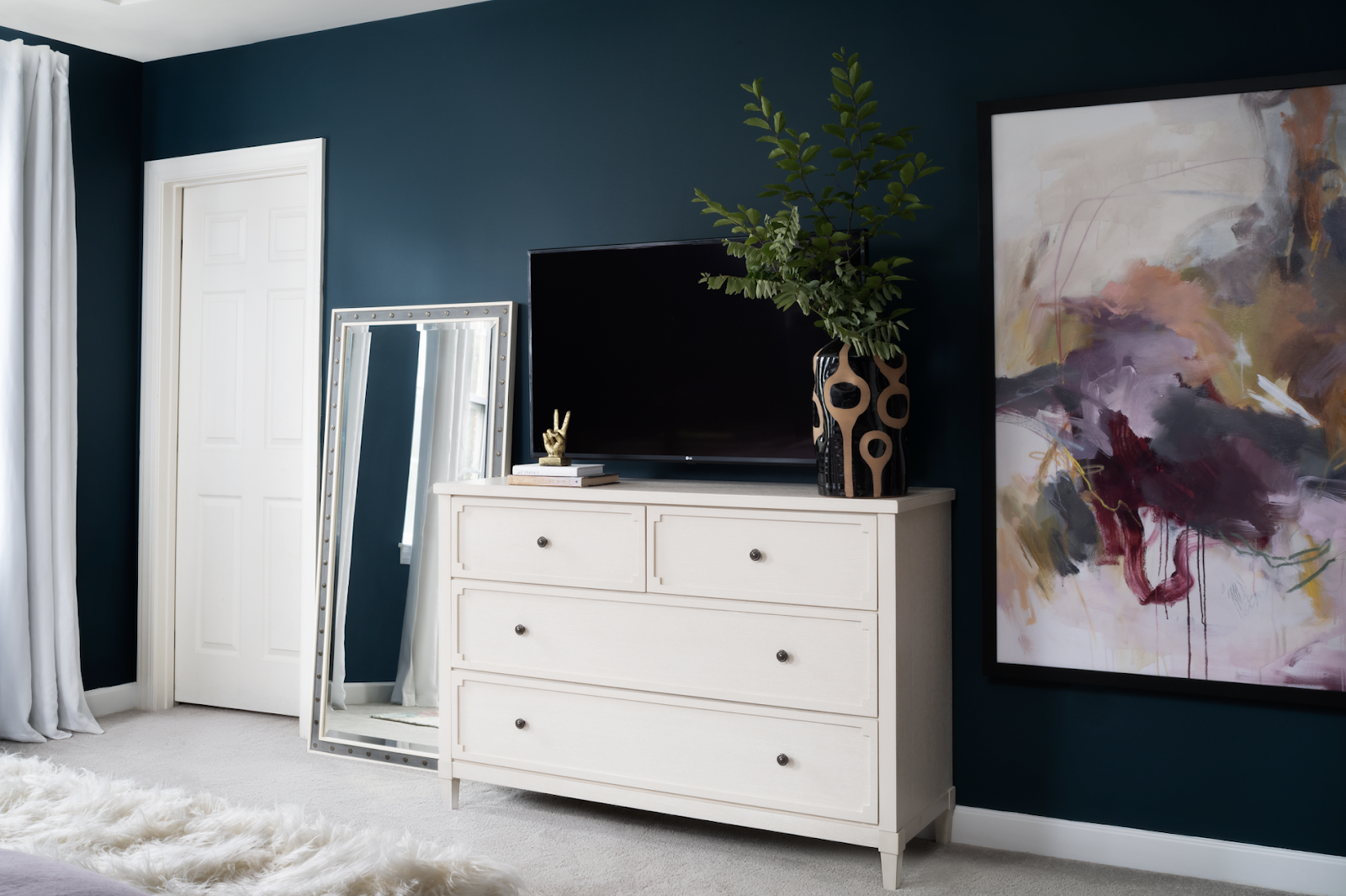 bedroom joyful restful design abstract art teal walls white dresser mirror joy street initiative